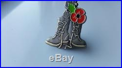 Poppy pin badge. Soldier helmet, rifle, boot, dog-tag poppy badge OUT OF STOCK